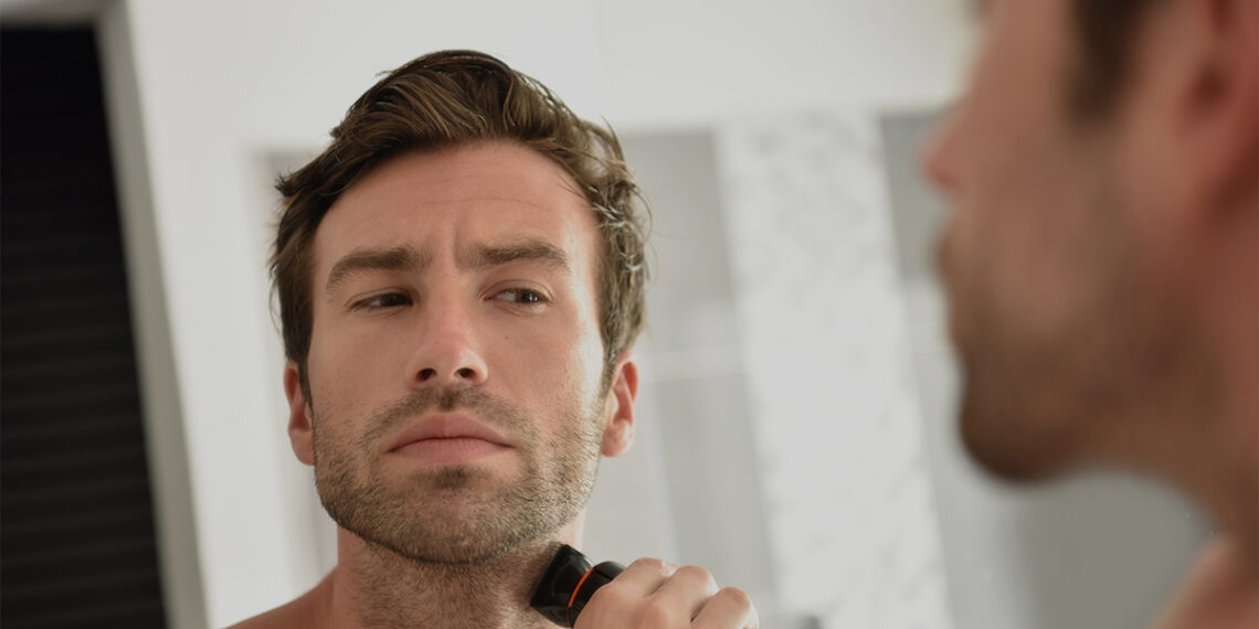 This is the cover photo for our Best Electric Shaver article. It features a man shaving with an electric shaver.