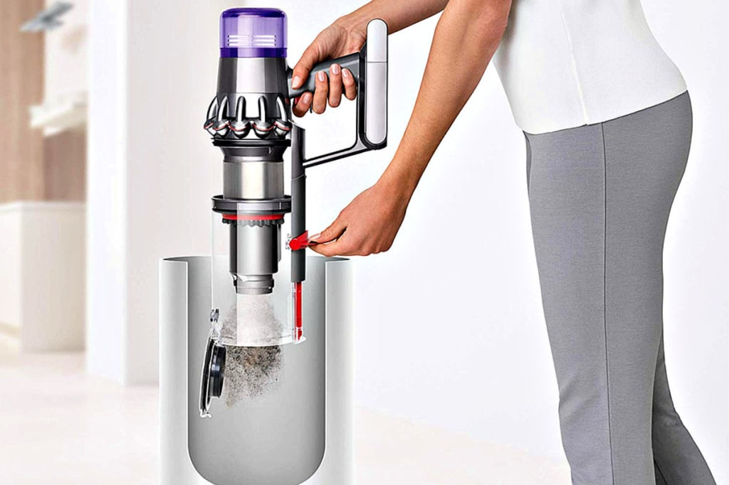 This is a mockup image of a person emptying the vacuum cannister of a Dyson cordless vacuum.