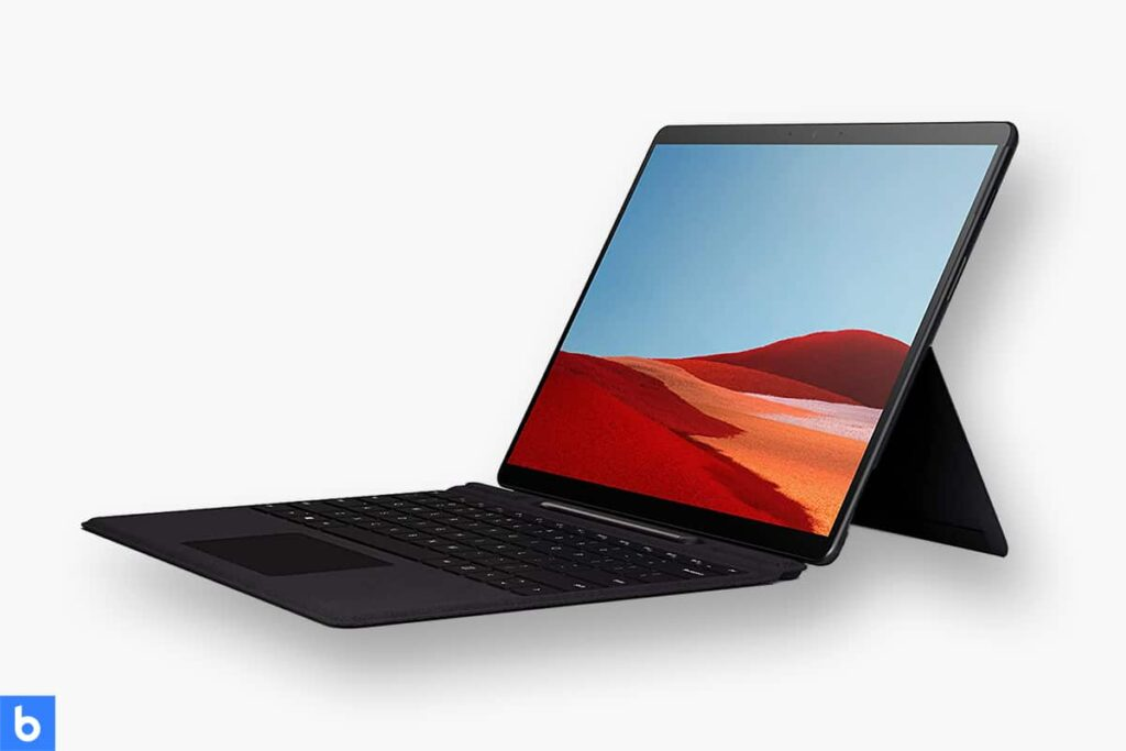 This is a product image in our Best Business Laptop for 2021 article. It is a photo of a Microsoft Surface Pro X Laptop overlaid on a minimalistic white background with a Burbro logo.