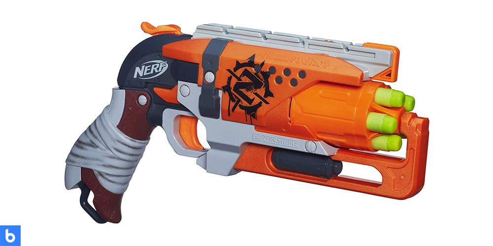 This is a photo of the NERF Zombie Strike HammerShot Blaster overlaid on a minimalistic white background with a Burbro logo.