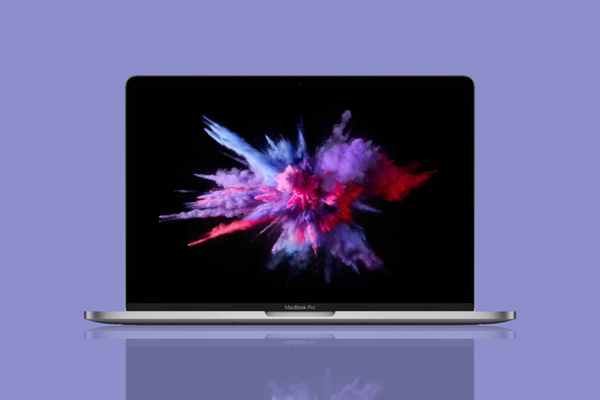 This is the cover photo for our Best Business Laptop article. It features a MacBook Pro overlaying a glossy purple background.