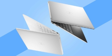 This is the cover photo for our Best Touchscreen Laptops article. It features two Dell XPS laptops hovering in the air, with a blue background.