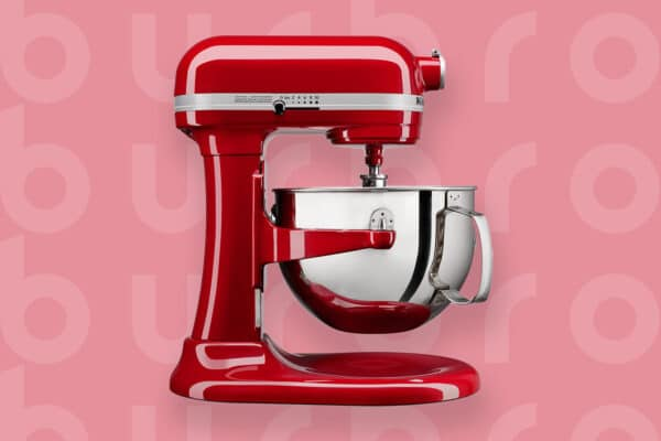 This is the cover photo for our Best Stand Mixer article. It features a red Cuisinart stand mixer overlaying a light red background with an embossed Burbro logo.