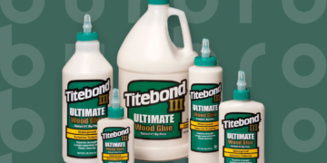 This is the cover photo for our Best Wood Glue article. It features various sized bottles of Titebond III Ultimate Wood Glue overlaying a green background with an embossed Burbro logo.