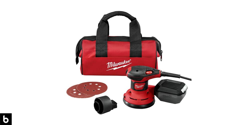 This is a product image for our Best Orbital Sander 2021 article. This is a Milwaukee Random Orbital Palm Sander with a carrying bag, sanding pads, and battery pack.