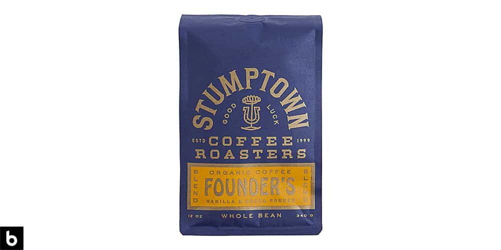 This is a product image, featuring a navy and gold bag of Stumptown Coffee Roasters whole bean coffee.