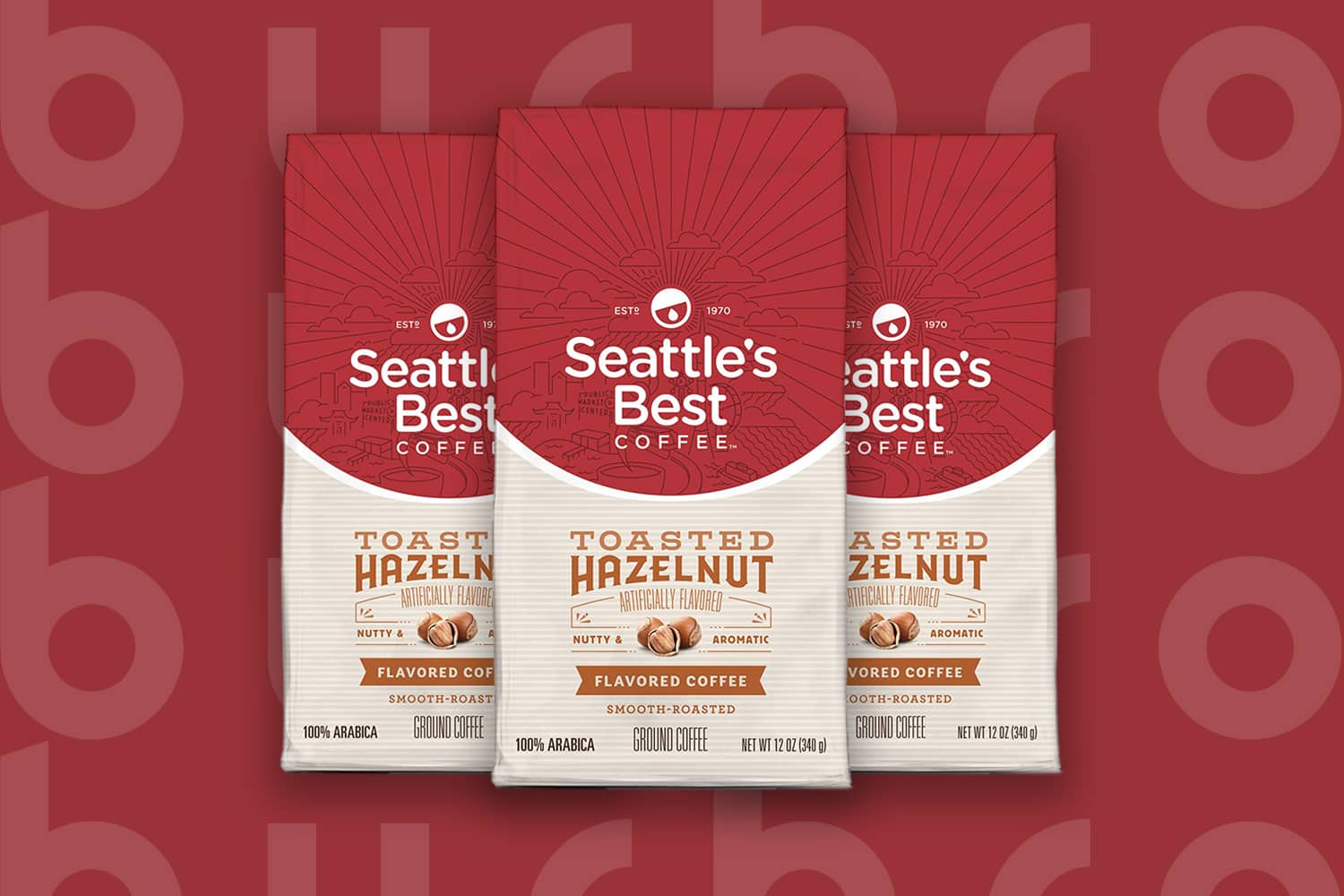 This is the cover photo for our Best Ground Coffee article. It features 3 bags of Seattle's Best Toasted Hazelnut ground coffee overlaid on a red background with embossed Burbro logo.