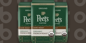 This is the cover photo for our Best Organic Coffee article. It features 3 green and brown bags of Peet's Organic French Roast Coffee, overlaid on a brown background with embossed Burbro logo.