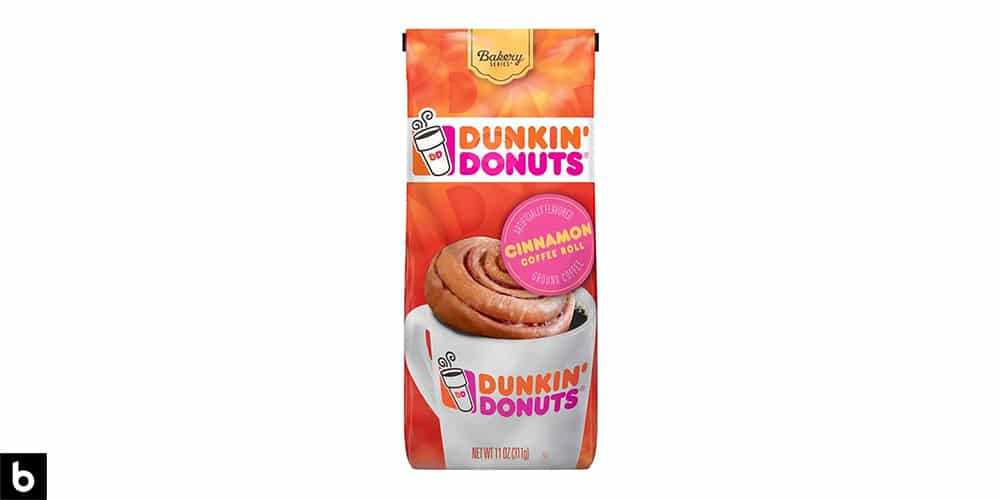 This is a product image, featuring a multicolored bag of Dunkin' Donuts Cinnamon Coffee Roll flavored coffee.