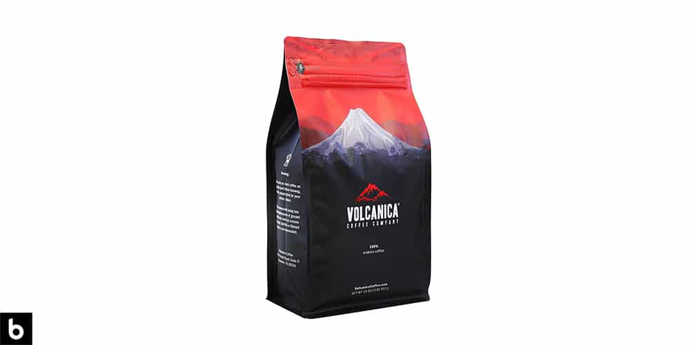 This is a navy and red colored bag of Geisha whole bean coffee. There is a picture of a mountain printed onto the bag.