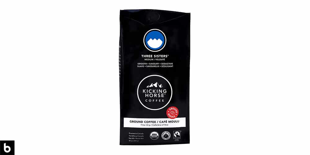 This is a product image for our Best Organic Coffee 2021 article. It features a black bag of Kicking Horse 'Three Sisters' organic ground coffee.