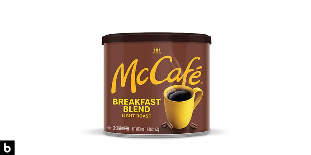 This is a product photo of a brown tin of McCafe Breakfast blend light roast ground coffee.