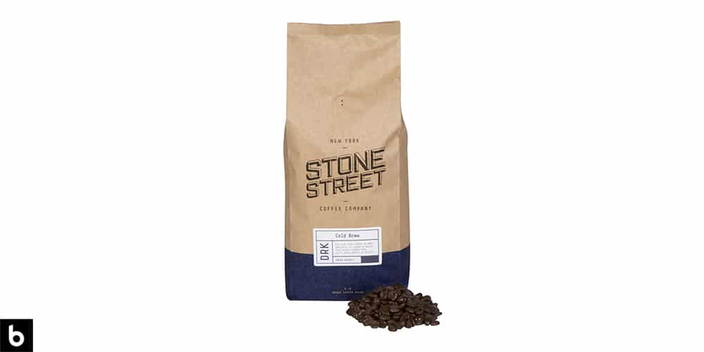 This is a navy and cream colored bag of Stone Street Whole Bean Coffee overlaid on a white background.