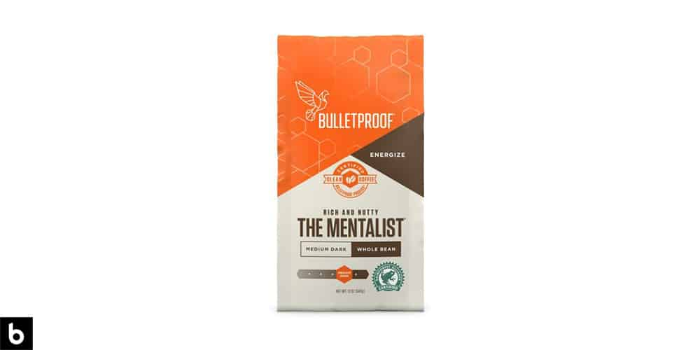 This is an orange, brown, and cream colored bag of 'The Mentalist' bulletproof Coffee Beans.