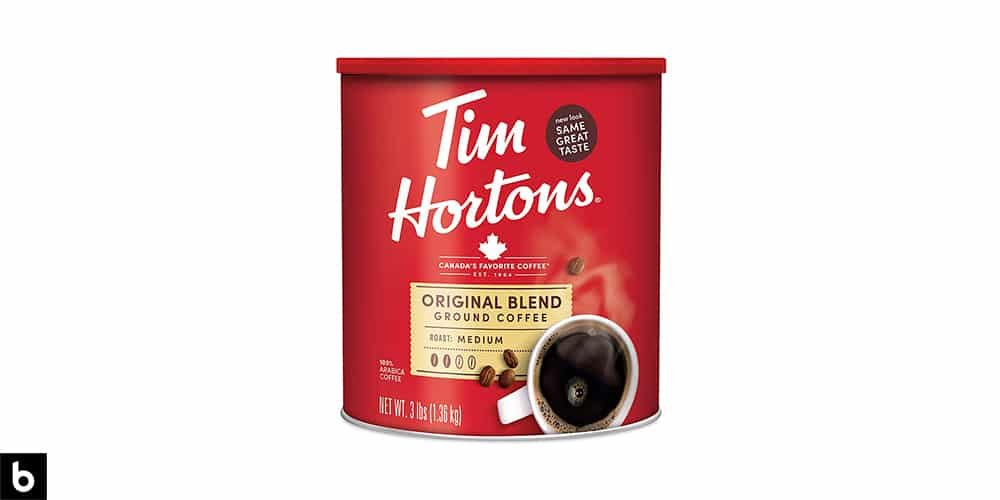 This is a product image of a red tin of Tim Hortons original blend ground coffee.