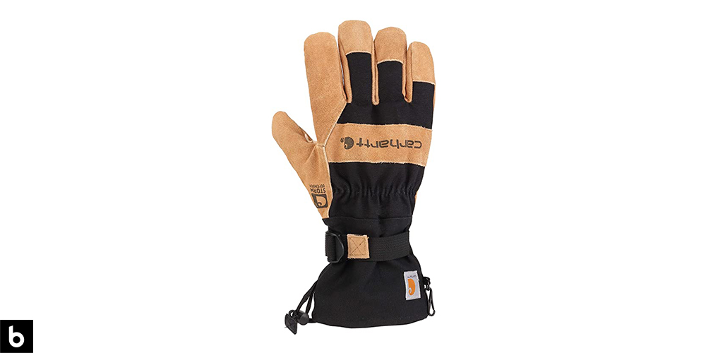 This is a product image, featuring a pair of black and tan leather Carhartt insulated winter work gloves.