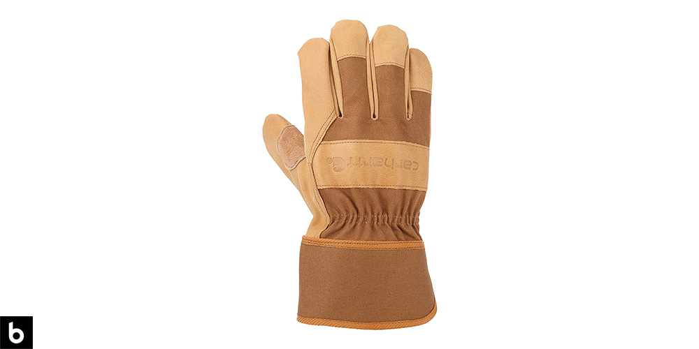 This is a product image for our best work gloves 2021 article. It features a pair of tan leather Carhartt work gloves.
