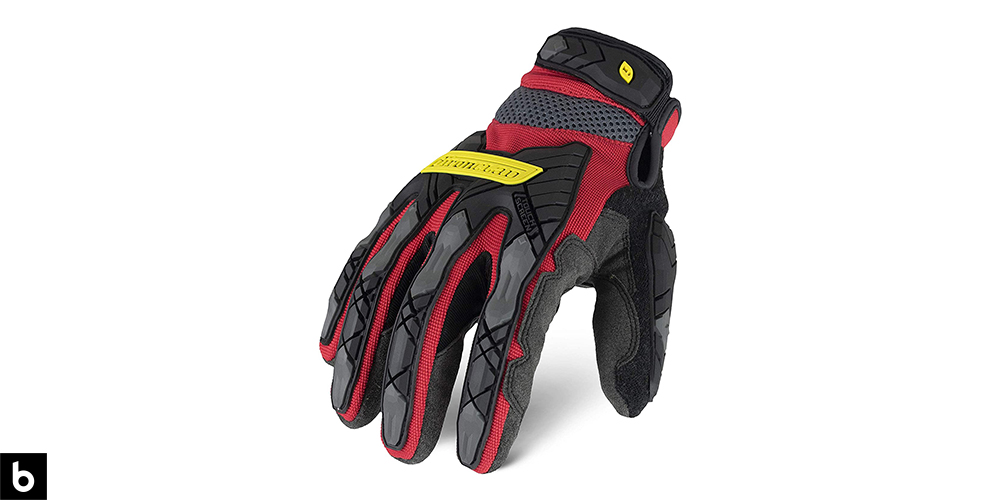 This is a product image, featuring a pair of black and red Ironclad Command Impact work gloves.