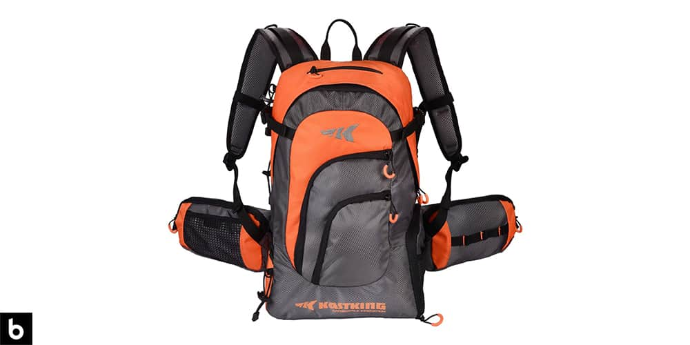 This is a product image, featuring a grey and orange KastKing fishing backpack.
