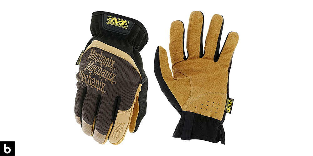 This is a product image, featuring a pair of black and brown Mechanix Durahide work gloves.