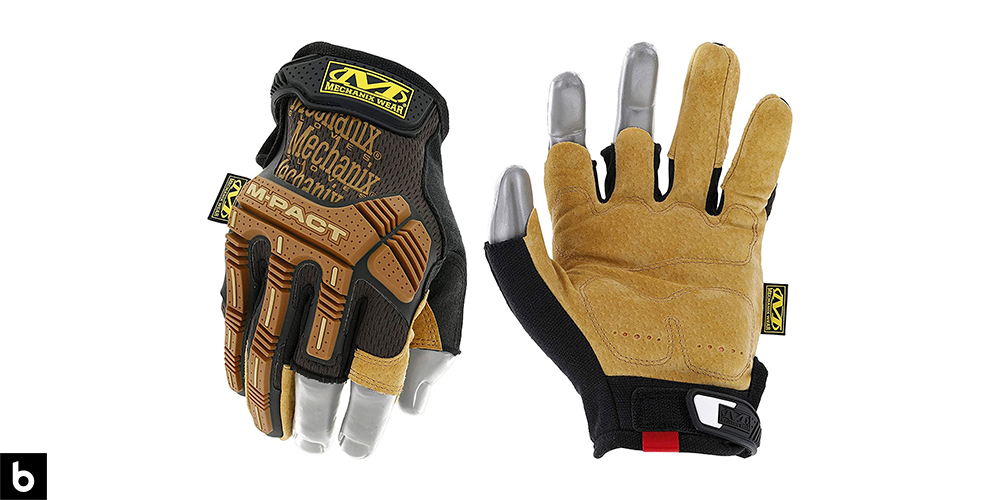 This is a product image, featuring a pair of brown and black Mechanix framing/construction gloves.